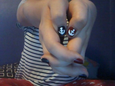 I painted my nails red and blue and painted anchors on them. :3 patriotic AND nautical. Even though the anchors don't even look that good, they were fucking hard, lol, I suck at painting nailz.