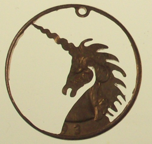 This is a unicorn cut from a quarter. So awesome. Unicorn Jewelry by bongobeads on Etsy