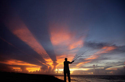 A fisherman casts his line as the sun sets on the outskirts of Havana, Cuba Picture: REUTERS (via Pictures of the day: 26 July 2011 - Telegraph)