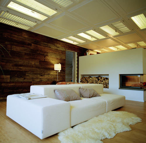 slatted doors (windows?) as skylights; weathered wood wall juxtaposed w/clean whites