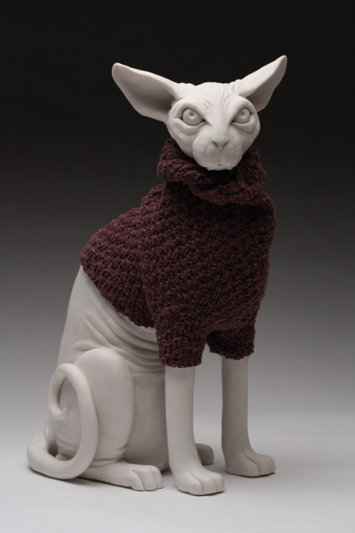 "Bethany Krull: Sweatered Sphinx, 2011, porcelain, modified sweater, 17""H x 10""W x 8""D"