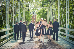 Evan and Jess cross one of Bucks County's famous bridges with their wedding party close behind.