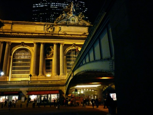 "nythroughthelens:  Grand Central Terminal at night. Midtown, New York City I was going to initially write about how I feel about this part of midtown but I got a little (ok, completely) side tracked reading about the fact that Lex Luthor's lair in the original Superman (1978) was supposedly set under Grand Central Terminal (the beautiful landmark building in this post). How did I not know this? ""A scene filmed in the 1978 film Superman of the men in 'Metropolis 46' who follow the villain Otis through the train tracks took place here. The lair of villain Lex Luther is also supposedly underneath the station."" - Source Grand Central Terminal has been utilized in a few other notable film scenes throughout the years. I love this bit about Grand Central and it's role in film written by Caryn James for the NY Times: ""To walk through the main concourse at Grand Central Terminal is to step onto a real-life movie set. Cary Grant passes through it while escaping his would-be killers in ""North by Northwest."" Jim Carrey grabs Kate Winslet's hand and dashes across it in ""Eternal Sunshine of the Spotless Mind,"" watching people vanish one by one as his memory is erased. Most tellingly, it is the site of a pivotal moment in ""The Fisher King,"" when Robin Williams, as a pure-hearted, emotionally unbalanced man, spots the quite plain woman of his dreams heading for her train. Suddenly everyone in the room breaks into a waltz, as this grimy, everyday place becomes a scene of glittering romance."" Source Grand Central Terminal, often incorrectly called Grand Central Station, or shortened to simply Grand Central is a train station located at 42nd Street and Park Avenue. It is the largest train station in the world. Although the terminal has been properly called Grand Central Terminal since it opened in 1913, many people continue to call it Grand Central Station. It features a whispering gallery, secret passageways and a room that used to be referred to as the 'kissing room' in the 1930s and 1940s. —- View this photo larger and on black on my Google Plus page —- Buy ""Grand Central Terminal at Night"" Posters and Prints here, Other versions of this print with writing and various borders can be viewed  here (any of them can be customized to have whatever background you desire): ""Grand Central Terminal at Night"" with Black Border, ""Grand Central Terminal at Night"" with White Border, ""Grand Central Terminal at Night"" with Grey Border, View my store, email me, or ask for help."