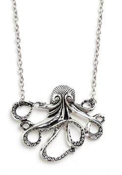 Oh my pimping octopus of the sea!If some one would care to buy me this, I will inappropriately touch you at all the appropriate times. (There's also a snazzy little pair of Squid Earings if you *really* like me…)