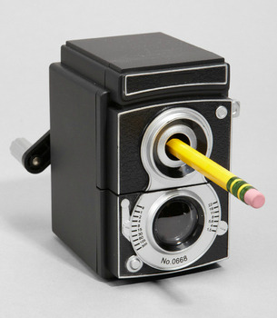 FUN! A vintage TLR pencil sharpener!Because I need to blog about random, not necessarily necessary things. Check out these other nifty office accessories (which in my dreams of nomadic management are totally useless, but for now are happiness- and good vibes-inducing).  Mustachioed Glasses Holder  Turntable Tape Dispenser (via Mashable.com: 15 Rad Retro Office Accessories)