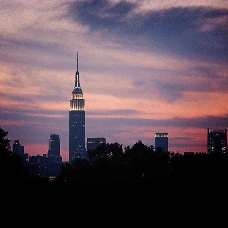 Empire State against an electric sunset.
