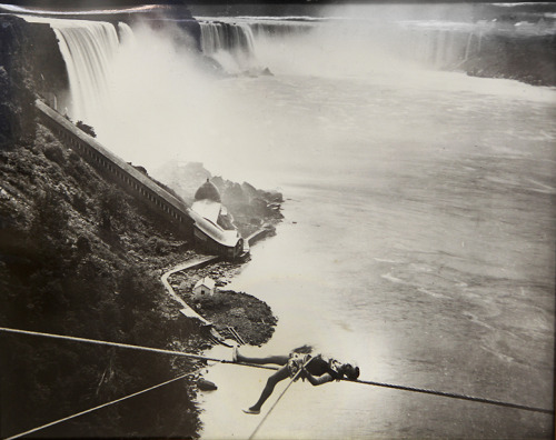 Niagara Falls considers a return to its daredevil past: As a high-wire artist requests to take a walk across the falls, the New York city sees an opportunity for an economic lift. Photo: At the Daredevil Museum in Niagara Falls, an old photograph show a tightrope walker over the falls. Such stunts have been banned for 50 years. View more photos on Framework. Credit: Los Angeles Times