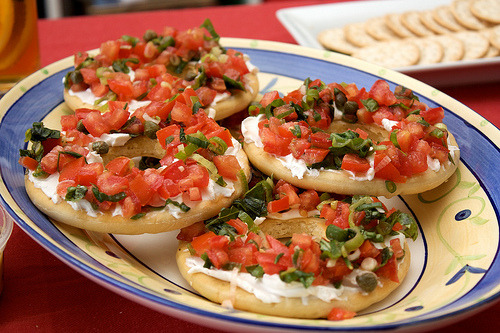 Vegan bruschetta with Tofutti cream cheese. CHOMP! CC image via flickr user penguincakes.