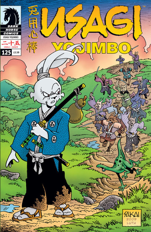 "Stan Sakai: Usagi Yojimbo (My #1 Favorite Artist of SD Comic Con 2011)   Sakai became famous with the creation of Usagi Yojimbo, the epic saga of Miyamoto Usagi, a samurai rabbit living in late-sixteenth and early-seventeenth-century Japan. First published in 1984, the comic continues to this day, with Sakai as the lone author and nearly sole artist.  The Japanese American National Museum in Los Angeles's Little Tokyo is presenting an exhibit entitled ""Year of the Rabbit: Stan Sakai's Usagi Yojimbo from July 9 through October 30, 2011. (Source)   Here's Kid and Sassy with Stan at SDCC, feelin' the love.  Stan was kind enough to take a picture with us…and one with his camera too! <3"
