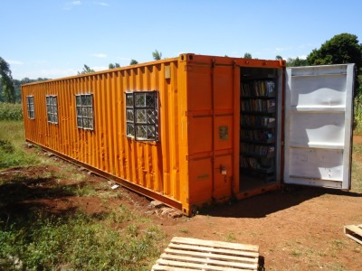 The bright red shipping container pictured above is now the HOME of the Our Reading Spaces Program at the Thika Primary School for the Blind and Kairi village in Kenya. Over 22,000 books were donated by individual donors in the USA and Books for Africa. Caring Georgia volunteers assembled to sort and pack these books for children and families in far away Kenya.