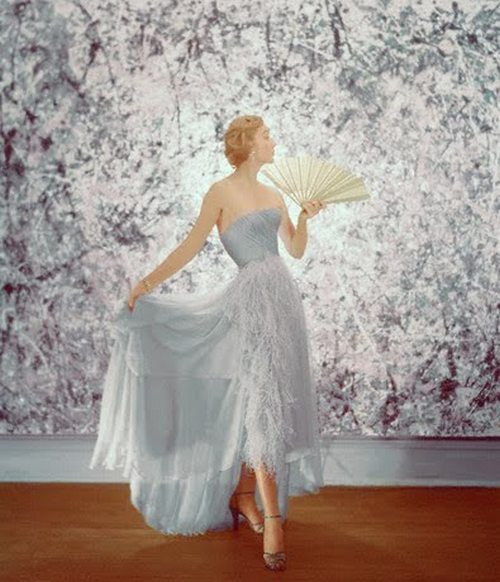 cinderella? wedding gown? future happiness?  theniftyfifties:  Model in a gown for Mademoiselle, 1951.  Photo by Cecil Beaton.
