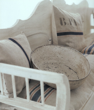 Rustic bench and grain sack pillows, cushions