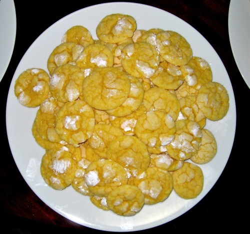 Yesterday on my way home from work, I had a craving for lemon cookies. It cracks me up when that happens. When, all of a sudden, out of nowhere, you get a craving for something VERY specific and obscure. It happens to me with weird things like shrimp cocktail, Popeyes biscuits, hard-boiled eggs, guacamole, those monstrous sour pickles you buy at baseball games… I usually end up not giving in, but last night I needed a lemon cookie. Here's the recipe I used from Tidy Mom (makes 3 dozen): Ingredients: 1 box Lemon Cake Mix 1- 8 oz container Cool Whip Free 1 egg 1/3 cup powdered sugar (for rolling) Directions: Preheat oven to 350° In medium bowl, beat cool whip, egg and cake mix until well blended. Dough will be thick and sticky. Drop by teaspoonfuls into a bowl of powdered sugar and roll to coat. Place on parchment lined cookie sheet and bake for 10-12 minutes