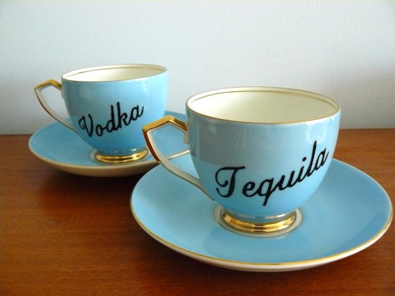 tallgirltales:  A surefire way to liven up your next tea party. Or…class up your next pre-party.  Hello subversive tea cups. Love. WANT.