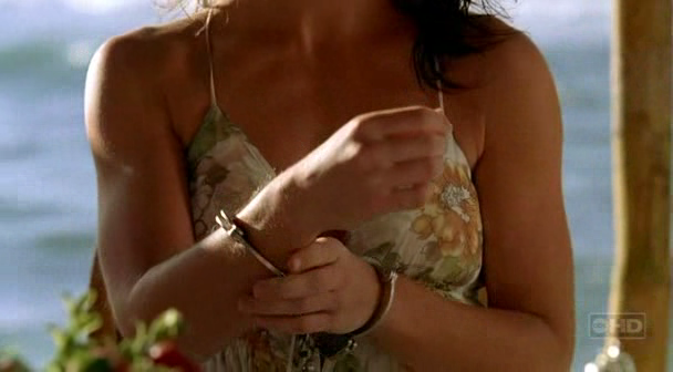 Actress Evangeline Lilly handcuffed in Lost, as Kate Austen celebrity actress kate austen evangeline lilly handcuffed handcuffs