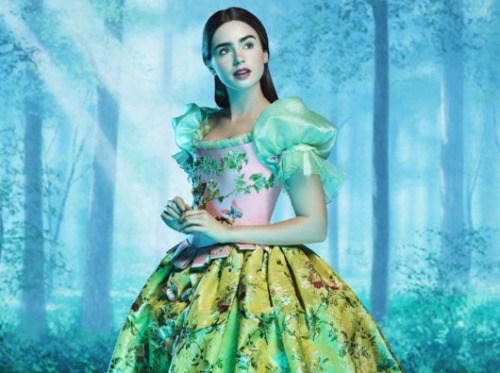 The Brothers Grimm: Snow White starring Lily Collins as Snow White, Julia Roberts as the Evil Queen, and Armie Hammer as Prince Andrew Alcott. SO hell yea, I love it when Hollywood retells fairy tales.