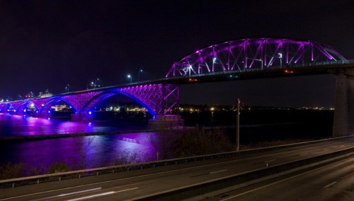 skatieb:  pegasuslighting:  Peace Bridge, with some 700 RGB LED color-changing light fixtures!  GIVE ME THIS JOB.