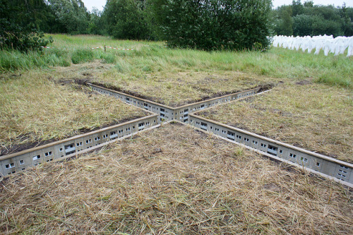 laughingsquid:  Artist EVOL Installs Miniature City Underneath Grassy Field