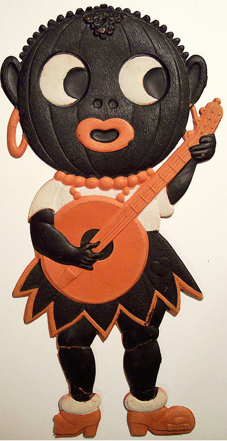 German diecut black pumpkin girl. It was a different time back then… http://www.flickr.com/photos/vintagehalloweencollector/