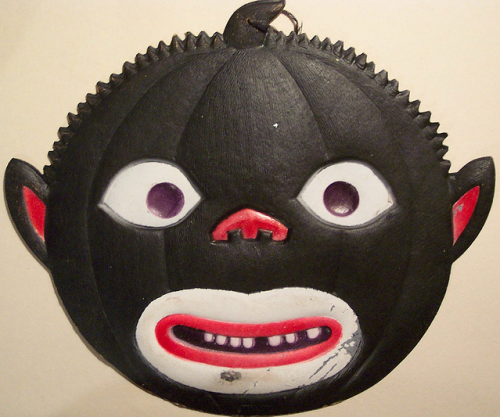 Black face pumpkin die cut.  http://www.flickr.com/photos/vintagehalloweencollector/