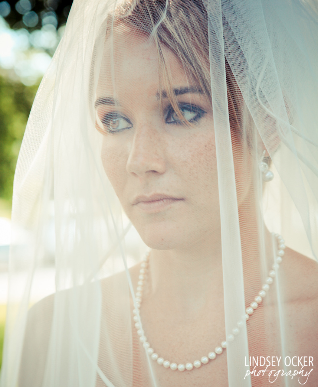 Last weekend's bride, enjoying a moment of quiet before walking down the aisle.