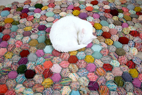 hedgehog76:  The Beekeeper's Quilt Knitted in sock yarn, the little hexagons are actually double-sided and stuffed! I have to knit am knitting this. Right. Now. The pattern is available on Ravelry  Think I have to start doing this too :)