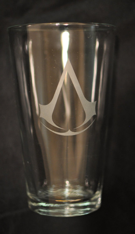 thedrunkenmoogle:  Assassin's Creed Pint GlassCreated by Etsy user DrinkingWithFriendsFor sale on Etsy - $12.00