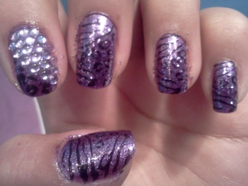 Purple sparkely zebra rhinestone nails yay