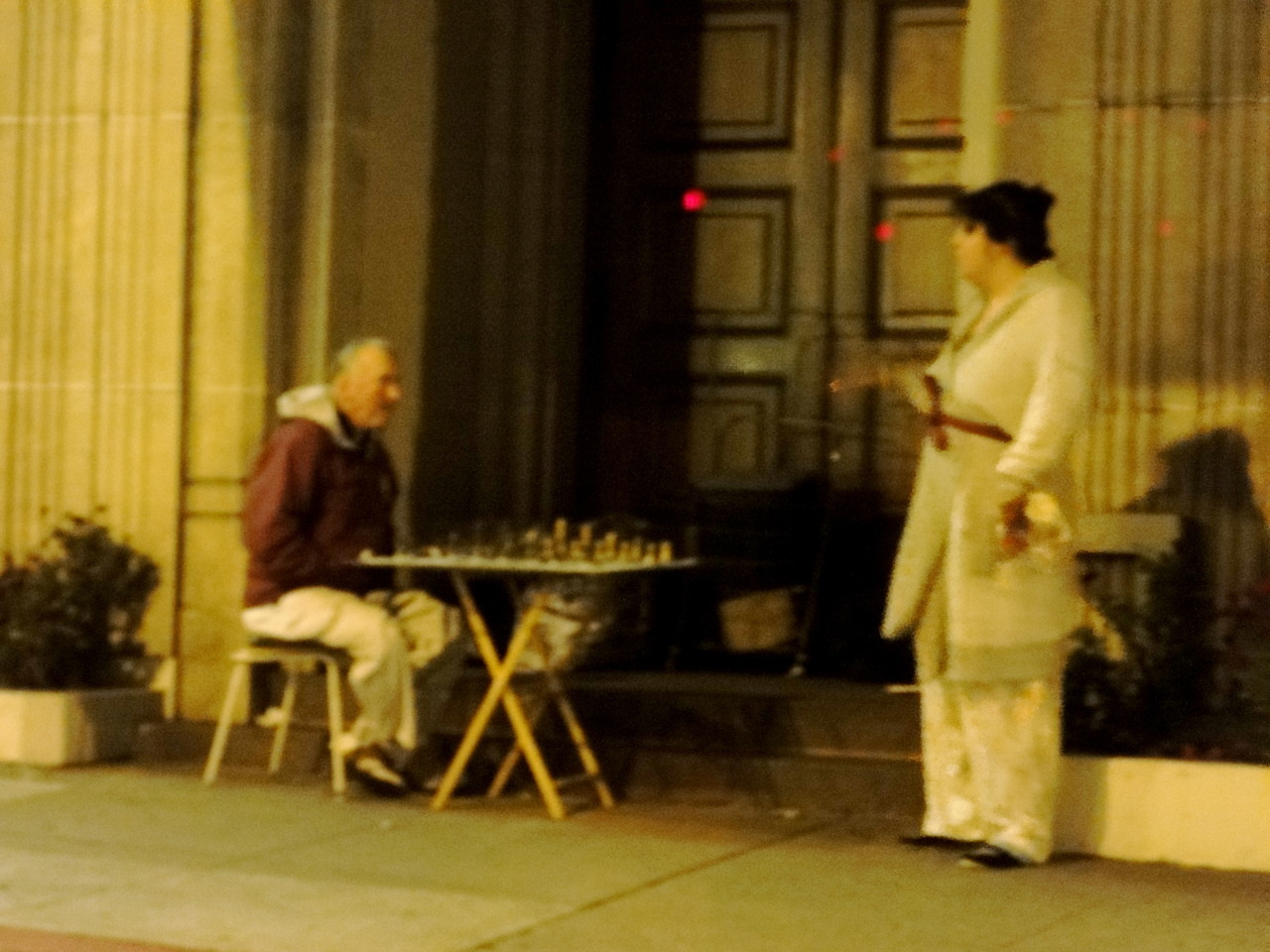Playing chess outside a mortuary on Divisadero and Geary.  Bathrobes.  10:30 or so at night.  Nothing amiss here.