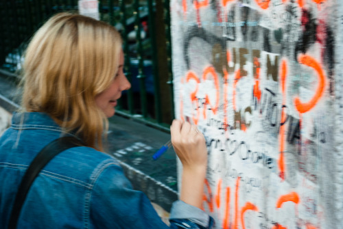 Writing on the Beatles wall outside Abbey Road Studios.