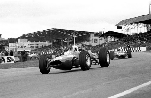British GP, 1964. John Surtees in the Ferrari 158 leads Jack Brabham in the Brabham BT7.