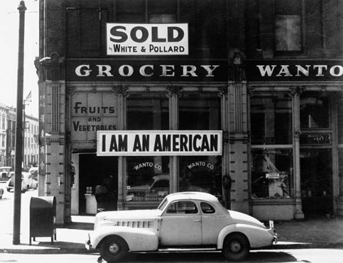 "The Japanese-American owner of a grocery store in Oakland, CA, closed  following evacuation orders hung a sign reading ""I AM AN AMERICAN""  the  day after the attack on Pearl Harbor.  April 1942."