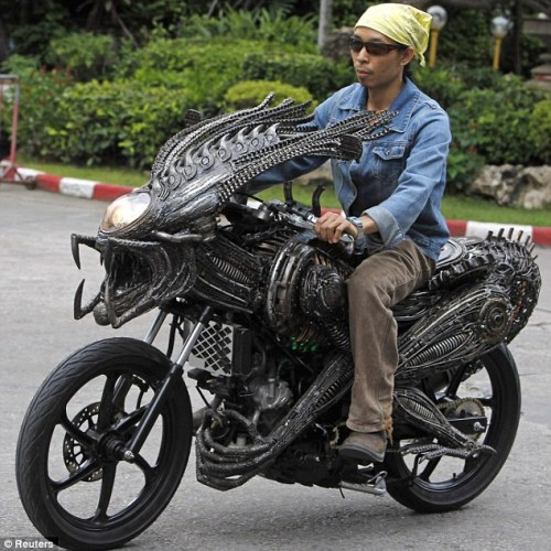 richardtherough:  GOT ALIEN-MOTOR-BYKE? This remarkable motorbike looks like it's straight out of a film set - but remarkably an artist has made it out of spare parts. The  Bangkok worker used recycled materials from old cars and bicycles to  create a monster machine which is sculpted to look like a beast. Despite being cobbled together from scrap parts, the spectacular motorcycle works - unlike many sci-fi film props. Roongrojna  Sangwongprisarn, 54, created it out of spare parts in his workshop in  Thailand. He has four shops across the country - named the Ko Art Shop -  and exports his creations to clients all over the world.