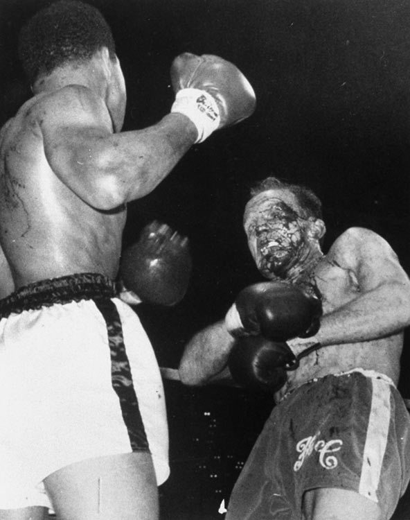 l18mbr:  Muhammad Ali reduces the late Henry Cooper to a bloody mess in 1966.