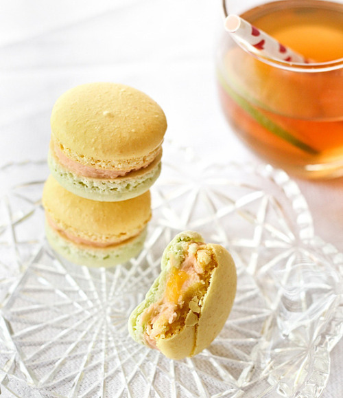 Lemon, Lime & Bitters Macarons - Based on the popular Aussie drink, these macarons have lemon and lime shells with a bitters buttercream @ raspberri cupcakes
