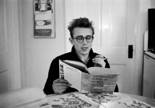 theniftyfifties:  James Dean reading poetry, 1955  I love his glasses.