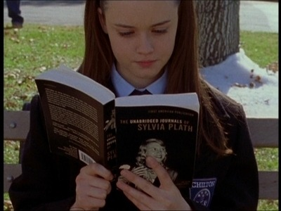 I hated the freaking Gilmore Girls, but I need to make a montage of girls reading Sylvia Plath. (I USED to have the URL of an article which analyzed them all, but I lost it. sigh.)