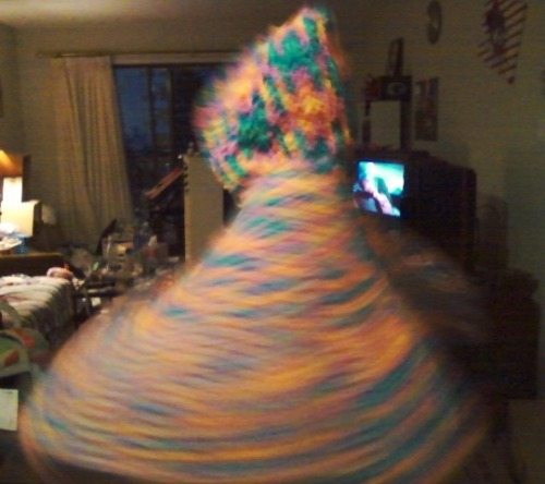 This is me spinning in the rainbow poncho that I made for my friend so she could take it to shambhala.  I really hope she likes it.