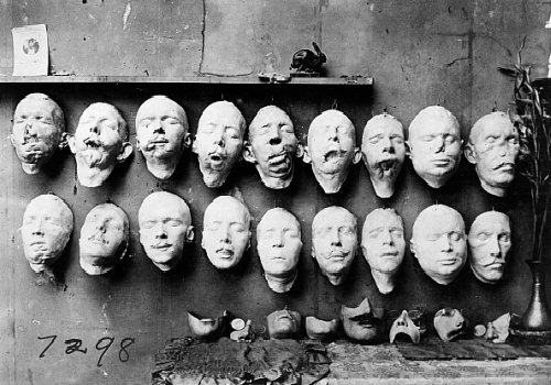World War I Masks by Anna Coleman Ladd, 1918The top row are casts taken from soldiers mutilated faces, the bottom row shows masks of their faces before their injuries, made from pre-war photographs. On the table are masks made to fit over the disfigured part of the face. [ftp]