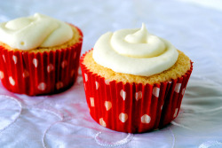 Champagne Cupcake with Strawberry Preserve Filling and Whipped White Chocolate Frosting.