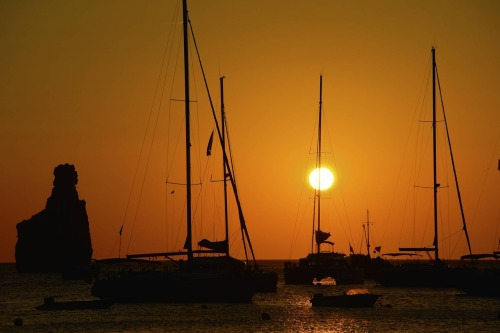 Sunset Shot taken on a small beach in Ibiza, two summers ago. Camera: Nikon D80 Lens: AF-S DX Zoom-Nikkor 18-135mm f/3.5-5.6G IF-ED Aperture: f/8Shutter speed: 1/1000 sec.ISO: 100