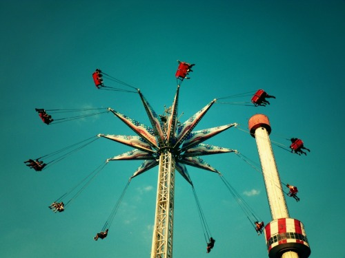 "Amusement park swing ride. Coney Island. Brooklyn, New York City  Summer is: wind in the hair, warm sun on bare skin, laughter blended with the sound of amusement park whirs, ice cream cones that drip from melting too quickly and a face that hurts from smiling too broadly.    —-  View this photo larger and on black on my Google Plus page  —-   Buy ""Summer at Coney Island"" Posters and Prints here, View my store, email me, or ask for help."