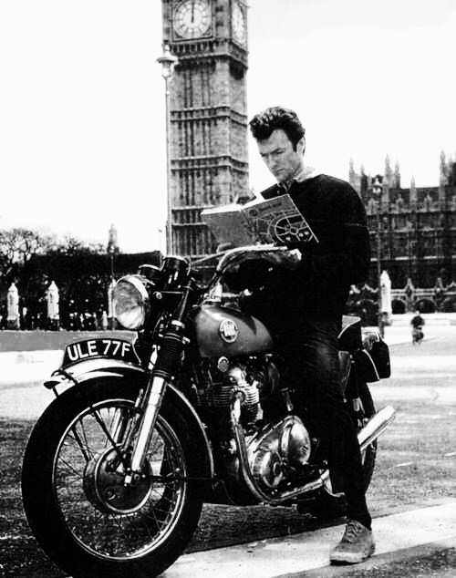 Clint Eastwood reads.  Clint Eastwood touring London on his motorcycle during the making of Where Eagles Dare, 1968.