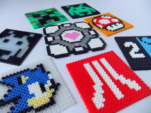 These are just some retro/gaming beer coasters I created using Hama beads. The companion cube is probably my favourite so far. The Creeper was my own idea and the Space invader on left glows in the dark. I'm always looking for new ideas for these.