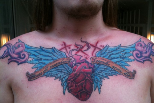 Oh, and btw: my chestpiece, right after it was finished. The text on the banner is dedicated to Four Year Strong. The three X's are straight edge.