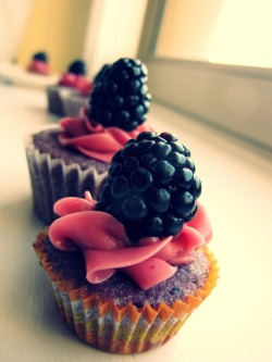 Buttermilk and Blackberry Cupcake with Blackberry Buttercream Frosting, and a Blackberry.