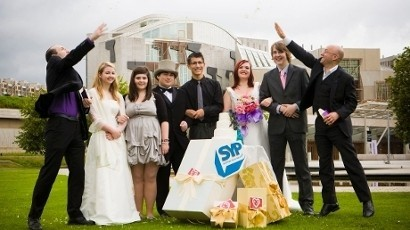 "Young Scottish politicians in campaign for same-sex marriages  Members of the Scottish Youth Parliament (SYP) donned wedding dresses and morning suits in a bid to urge the Scottish Government to allow same-sex couples to get married. Their Love Equally campaign, launched on Monday, follows research by the Equality and Rights Commission which shows that the majority of Scottish people support marriage equality. While civil partnerships have been allowed between couples of the same sex in the UK since 2005, marriage is not legal. In 2009, the Scottish Government rejected a 1317-signature petition by NUS Scotland calling for the amendment of legislation to allow same-sex marriage and mixed-sex civil partnerships in Scotland on the basis that legalisation of same-sex marriage would require changes on a national level, concerning matters such as pensions and inheritance law. In February of this year, however, members of the UK Government announced their intention to conduct a consultation on marriage laws. Grant Costello, 18, chair of the Scottish Youth Parliament said: ""Our hope is that the Scottish Government will legislate on equal marriage rights. They have promised to do it at some point during their five year term but I don't see a reason why they can't do it now. ""It shouldn't be something that even needs debated in my opinion; it's something that quite obviously should be passed into law. Hopefully we'll convince them that young people want this."" The SYP voted for the national campaign after consulting with 42,804 young people across Scotland and conducting a debate amongst its 150 elected members. The group, which involves people aged 14 to 25, now aim to spread their message through a series of events, including festivals, youth group meetings and street activities. Grant added: ""We'll be doing some really unique and fun things. We are a youth organisation and we do recognise that while people are extremely passionate about politics, it can be a bit boring sometimes, so we like to spice it up a bit and we like to make it entertaining."""