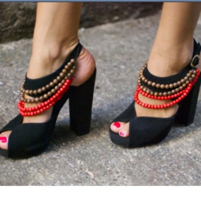 what a good DIY idea. attaching strings of beads to plain pair of black heels (open toed) to jazz them up. love! [via: @apairandaspare]