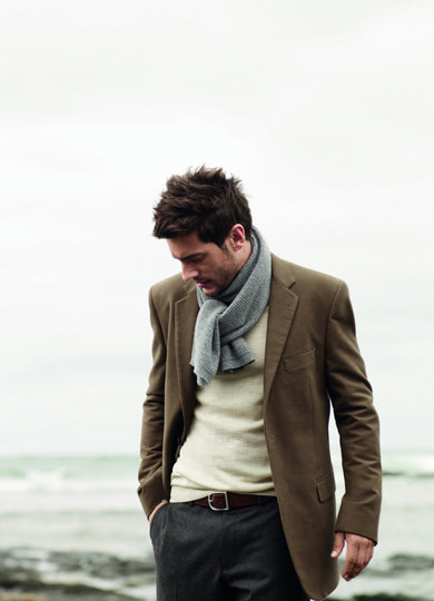 "thoughtsandviews:  How a scarf should be worn without looking overly fruity.  How can you comment on that shitty little ""scarf"" without taking note that that jacket is entirely too large for our deep, contemplative model?  Further, that ""scarf"" looks like a sleeve ripped off an American Apparel thermal.  So where does that get us?  Well, for starters, homeboy is 0 for 2.  But beyond that, the real problem is that this photo generated 131 notes, and not a single one of them realized how awful this guy looks."