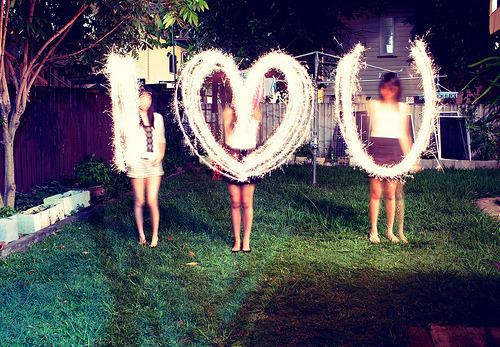 Sparklers spell out special letters and symbol.
